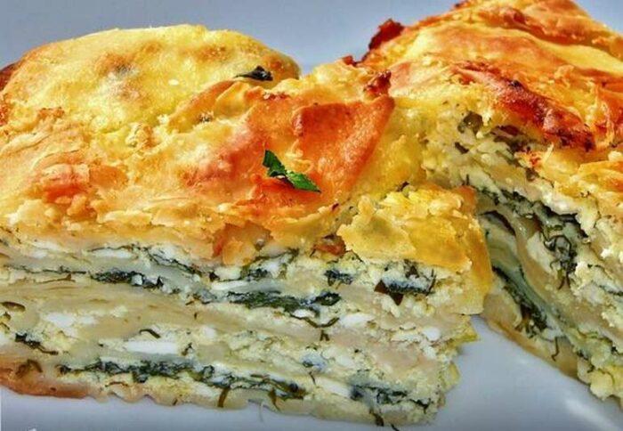 Закусочный пирог на сметане с брынзой и зеленью